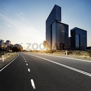 urban road in modern city at sunrise
