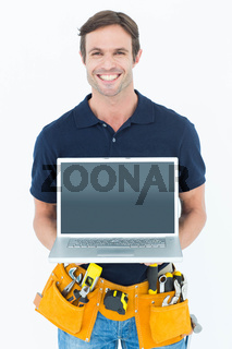 Happy architect holding laptop