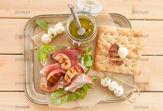 Sandwich with raw ham and grilled peaches