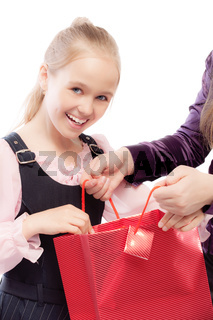 Young girl opens bag