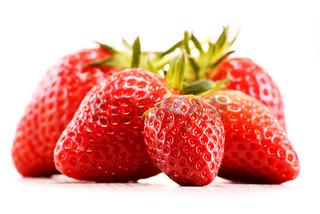 Fresh organic strawberries isolated on white background.