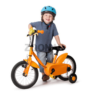 Portrait of a cute boy on bicycle
