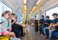 passengers sit in a metro train