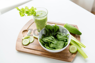 close up of fresh green juice glass and celery