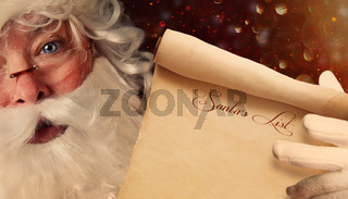 Closeup of Santa Claus holding a Santa List