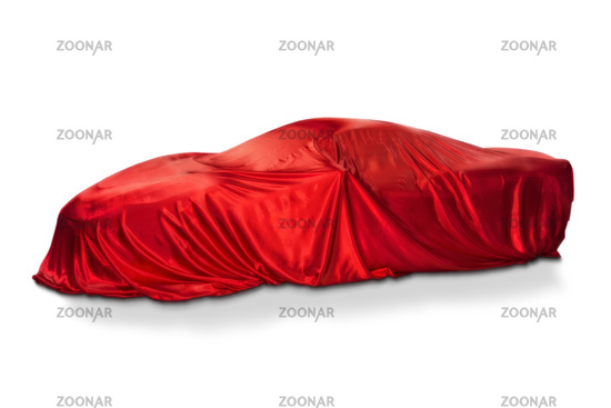 Sports car under a red cloth
