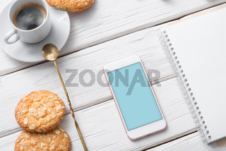 White smart phone mock up over cafe table. Clipping path included.