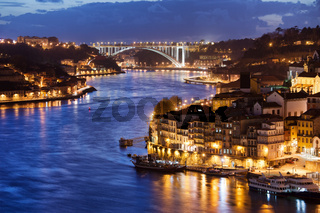 City of Porto by Douro River at Night in Portugal
