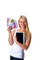 Blonde with euro notes and tablet in hand