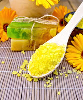 Salt yellow and soap with calendula on bamboo