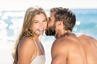 Happy couple in swimsuit embracing