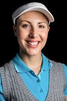 Golf player on black background