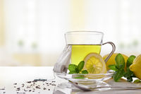 Green tea with mint and lemon with teabag front view