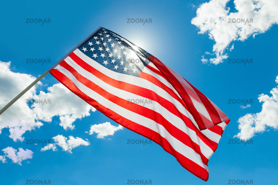 USA flag waving on blue sky background