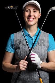 Golf player posing with golf club