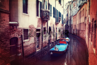 Retro style image of small canal in Venice