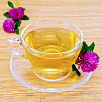 Herbal tea with clover on bamboo napkin