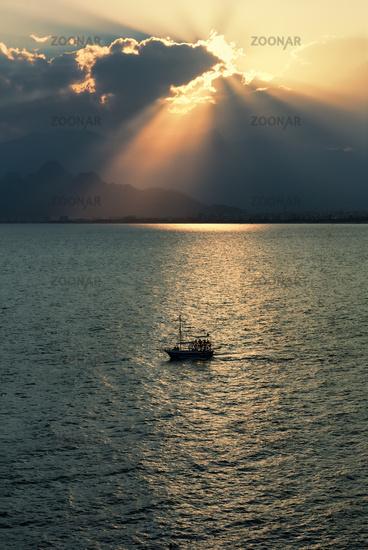 Ship in Antalya bay at sunset in Turkey
