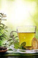 Oriental green tea with mint and lemon on bamboo closeup