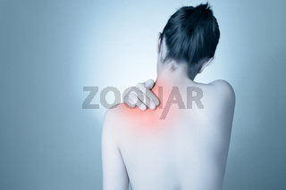 Rear view of a young woman touching her back