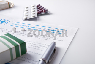 Guidelines and medical prescription with drug blisters elevated view