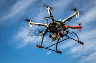 airborne hexacopter drone carrying camera