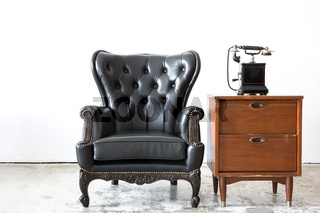 Retro leather chair with telephone