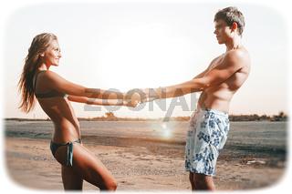 happy couple enjoying vacations on the beach