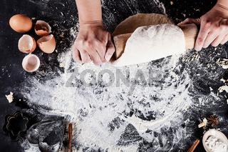 Making cookies on the blackboard with eggs, flour, cinnamon, top view