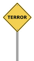 Yellow warning sign with the text Terror.