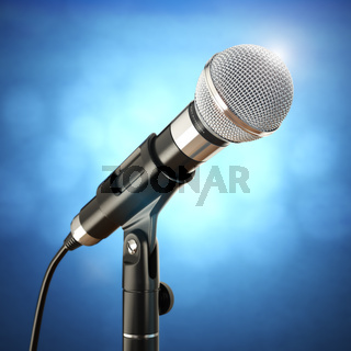 Microphone on the blue abstract background