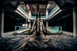 Dramatic view of damaged escalators in abandoned building. Apocalyptic and evil concept