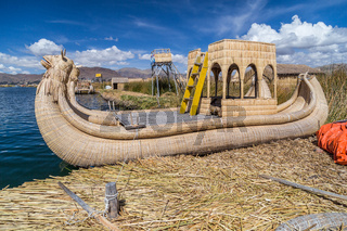Canoe boat at Uros floating island and village on Lake Titicaca near Puno