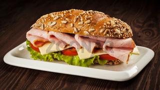 Ham sandwich on wooden background
