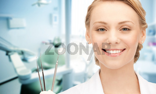 happy young female dentist with tools