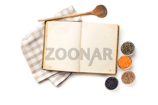 old recipe book and lentils legumes