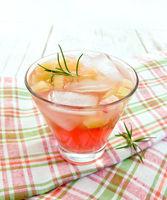 Lemonade with rhubarb and rosemary on napkin
