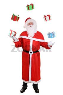 Weihnachtsmann Nikolaus Portrait beim Jonglieren von Geschenke an Weihnachten Freisteller