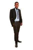 Afrikanischer Manager stehend im Anzug