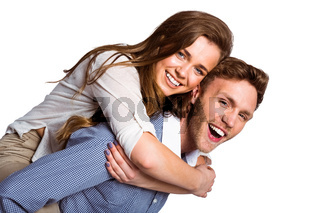 Smiling young man carrying woman
