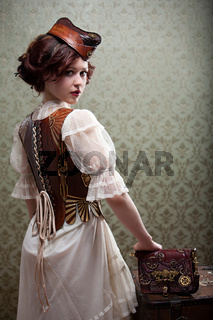 Junge Frau trägt ein Designer Steampunk Leder Korsett