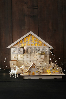 Wooden holiday houses with lights
