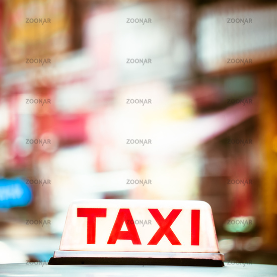 Abstract cityscape with taxi car