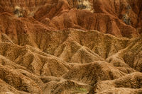 Detail of Drought red orange sand stone rock formation in Tatacoa desert, Huila