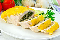 Roll chicken with spinach and cucumber on board