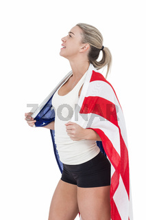 Female athlete with american flag on her shoulders
