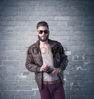 Fashion model in front of brick urban wall