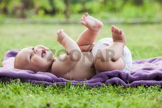 Little boy on lawn