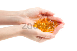 Omega 3 in female hands.