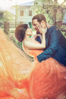 Bride and groom sweet kissing